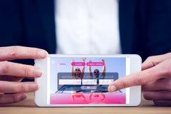 Immagine composita della donna di affari che per mezzo del suo pc della compressa Fotografia Stock Libera da Diritti