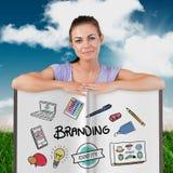 Immagine composita della donna graziosa che mostra un libro Immagine Stock Libera da Diritti