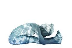 Immagine composita della donna tonificata che fa la posa di paschimottanasana Fotografie Stock