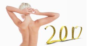 Immagine composita della donna topless che lega capelli Fotografie Stock Libere da Diritti