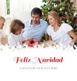 Immagine composita della famiglia allegra che celebra natale Fotografie Stock Libere da Diritti