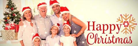 Immagine composita della famiglia che posa per la foto fotografie stock