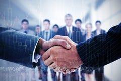 Immagine composita della gente di affari che stringe le mani Immagini Stock