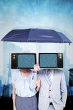 Immagine composita della gente di affari che tiene un ombrello nero fotografia stock libera da diritti