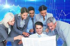 Immagine composita della gente di affari felice che esamina giornale Fotografie Stock Libere da Diritti