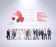 Immagine composita della gente di affari multietnica che sta parallelamente Fotografie Stock Libere da Diritti
