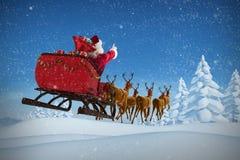 Immagine composita della guida del Babbo Natale sulla slitta con il contenitore di regalo Fotografia Stock Libera da Diritti