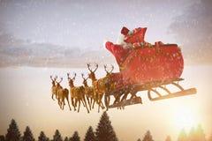 Immagine composita della guida del Babbo Natale sulla slitta con il contenitore di regalo Fotografie Stock