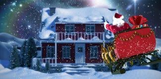 Immagine composita della guida del Babbo Natale sulla slitta con il contenitore di regalo Immagine Stock Libera da Diritti