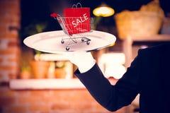 Immagine composita della mano con i guanti bianchi che tengono un vassoio d'argento Fotografia Stock Libera da Diritti