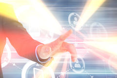 Immagine composita della mano dell'uomo d'affari che indica qualcosa Immagini Stock
