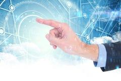 Immagine composita della mano dell'uomo d'affari che indica qualcosa Immagine Stock Libera da Diritti