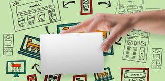 Immagine composita della mano femminile che mostra una carta Fotografia Stock Libera da Diritti