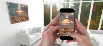 Immagine composita della mano femminile che tiene uno smartphone Immagine Stock Libera da Diritti
