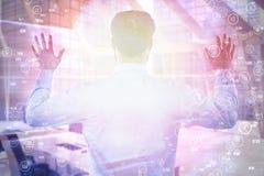 Immagine composita della retrovisione dell'imprenditore che finge di utilizzare schermo invisibile 3d Fotografia Stock