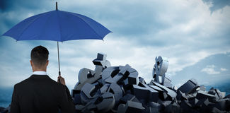 Immagine composita della retrovisione dell'uomo d'affari che porta ombrello blu Fotografie Stock Libere da Diritti