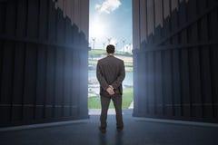 Immagine composita della retrovisione dell'uomo d'affari di classe che posa 3d Fotografie Stock Libere da Diritti