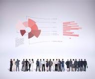 Immagine composita della retrovisione della gente di affari multietnica che sta parallelamente immagini stock libere da diritti