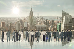 Immagine composita della retrovisione della gente di affari multietnica che sta parallelamente fotografie stock libere da diritti