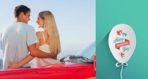 Immagine composita della retrovisione di abbracciare sveglio delle coppie Fotografia Stock