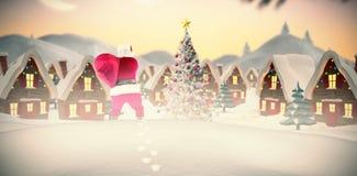 Immagine composita della retrovisione di Santa che tiene un sacco Fotografie Stock Libere da Diritti