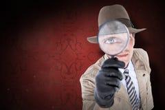 Immagine composita della spia che guarda tramite la lente Fotografia Stock