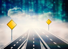 Immagine composita della strada sopra le nuvole con i segnali stradali su  Immagine Stock Libera da Diritti