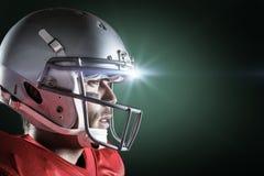 Immagine composita della vista laterale del casco d'uso dello sportivo fotografie stock