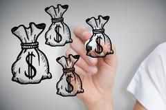 Immagine composita delle borse dei soldi del disegno della donna di affari Fotografie Stock