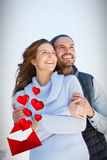 Immagine composita delle coppie felici che si abbracciano 3d Immagini Stock