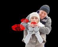 Immagine composita delle coppie mature di inverno Fotografia Stock