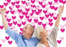 Immagine composita delle coppie mature felici con le mani su Immagini Stock