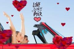Immagine composita delle coppie sorridenti che vanno insieme in vacanza Immagine Stock Libera da Diritti