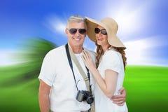 Immagine composita delle coppie vacationing Fotografie Stock Libere da Diritti