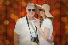 Immagine composita delle coppie vacationing Immagine Stock