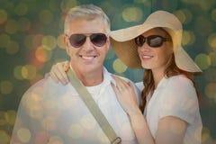 Immagine composita delle coppie vacationing Immagini Stock