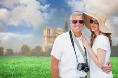 Immagine composita delle coppie vacationing Immagini Stock Libere da Diritti
