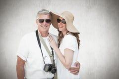 Immagine composita delle coppie vacationing Fotografia Stock