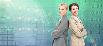 Immagine composita delle donne di affari serie che stanno indietro sopra posteriori Immagine Stock Libera da Diritti