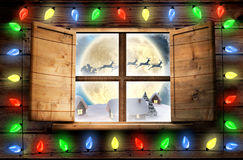 Immagine composita delle luci decorative che appendono in una forma Fotografia Stock