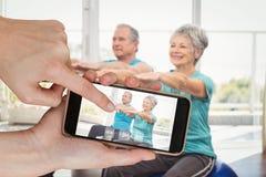 Immagine composita delle mani che toccano Smart Phone Fotografia Stock Libera da Diritti