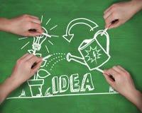 Immagine composita delle mani multiple che scrivono idea con gesso Fotografia Stock Libera da Diritti
