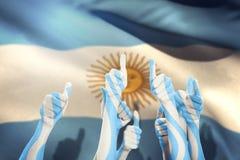 Immagine composita delle mani su e dei pollici alzati Immagini Stock Libere da Diritti