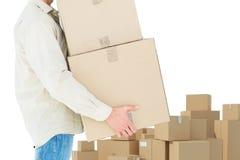 Immagine composita delle scatole di cartone di trasporto del fattorino Fotografia Stock Libera da Diritti
