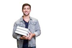 Immagine composita dello studente che sorride alla macchina fotografica in biblioteca Fotografia Stock Libera da Diritti