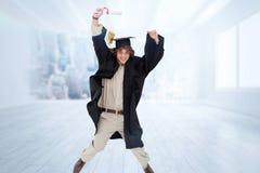 Immagine composita dello studente maschio nel salto laureato dell'abito Immagine Stock
