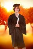 Immagine composita dello studente sorridente in abito laureato Fotografia Stock Libera da Diritti