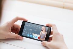 Immagine composita dello studente sul computer portatile fotografie stock