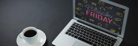 Immagine composita di caffè nero, della penna, dell'organizzatore e del computer portatile su fondo nero Fotografia Stock