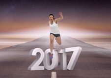 Immagine composita di 3D 2017 con funzionamento della ragazza di sport sulla strada Fotografia Stock Libera da Diritti